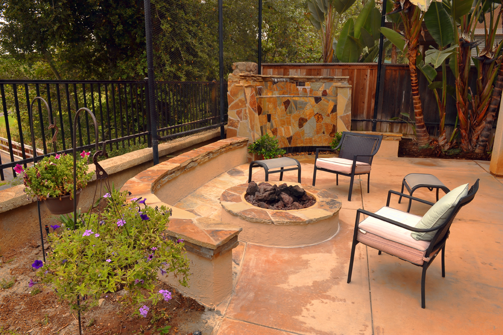 Backyard Fire pit using stone pavers with stone pavers on retaining walls and for hardscape Waterfall