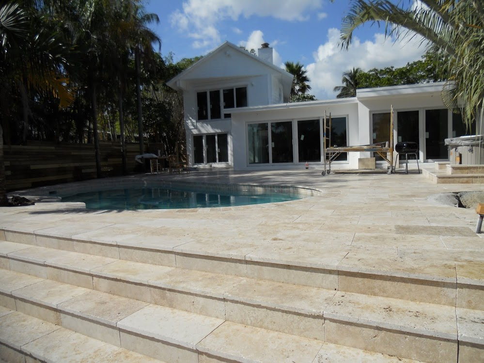 The marble steps and deck add enduring quality as another premier job | America Pavers