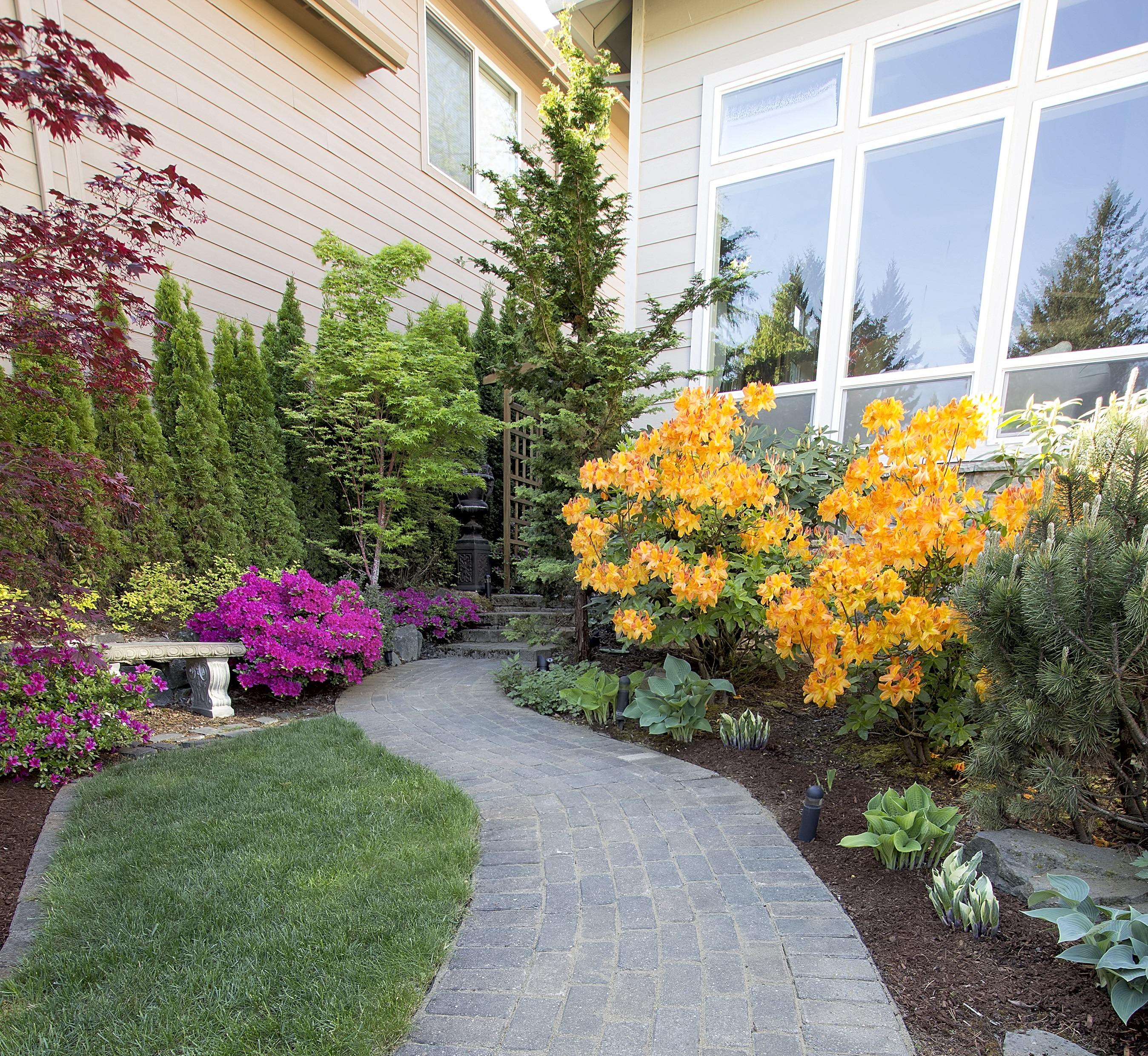 This brick pathway is a beautiful hardscape design installed by America Pavers